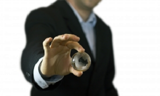 businessman_holding_crystal_globe